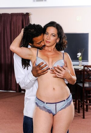 Soccer mom with dark hair loves black man's touches and stripping on camera