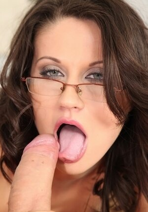 Dark-haired lady doesn't take eyeglasses off even when she's sucking the cock