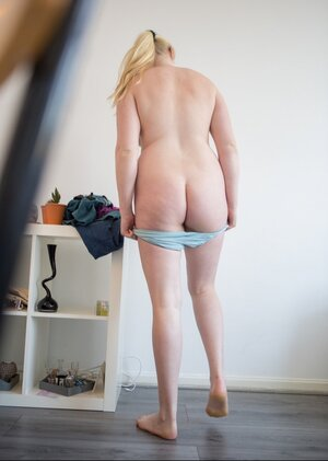 Unknowingly porky blonde kitten takes part in XXX shooting while getting dressed