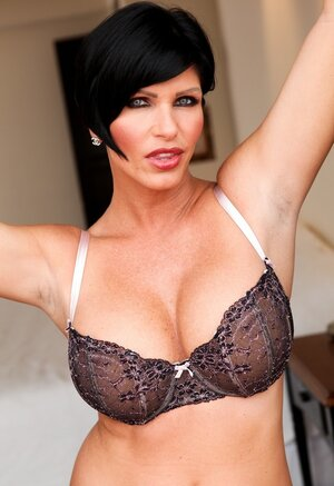 Brunette woman with short hair looks so yummy wearing this lingerie