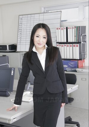 Pretty Far eastern office girl in black stockings is ready to show off hirsute vagina