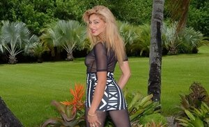 Latina chick in transparent outfit shows private parts in the fresh air