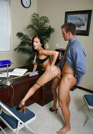 Comely brunette lures dean's assistant into quick sex in his cabinet